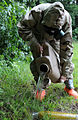 A member with the 202nd Explosive Ordnance Disposal Company, 201st Regional Support Group, pours decontamination fluid on a device suspected to be leaking a chemical agent during exercise Ravens Challenge VIII 140629-Z-WV152-827.jpg