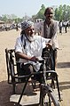A physically handicapped voter arrives at a polling booth to cast his vote, during the 5th Phase of General Elections-2014, at Patna Sahib, Bihar on April 17, 2014.jpg
