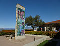 A piece of the Berlin Wall on the west side of the Reagan Library.jpg