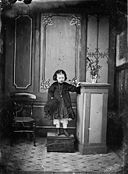 A young girl standing on a chest NLW3364884.jpg