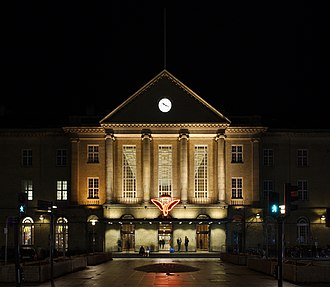 Aarhus Central Station - Front facade of Aarhus Central Station by night