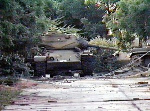 Battle of Mogadishu (1993) - Destroyed Somali National Army M47 tanks lay abandoned near a warehouse following the outbreak of the civil war.