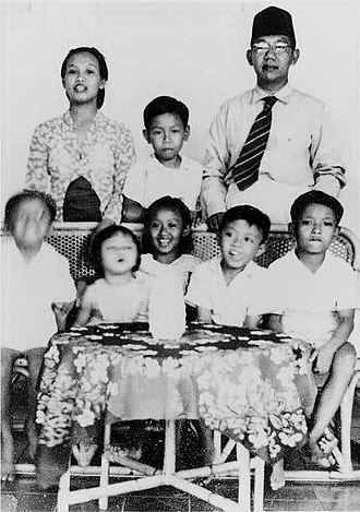 Abdurrahman Wahid - Abdurrahman standing between his mother and father, and behind his siblings and a friend of the family, circa 1952.