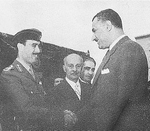 Ali Abu Nuwar - Abu Nuwar shaking hands with Egyptian President Gamal Abdel Nasser (right) in Egypt, 1956. Abu Nuwar was an advocate of Nasser's pan-Arabist policies.