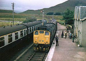 Achnasheen railway station - Loco-hauled trains pass at Achnasheen, September 1973