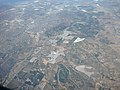 Aerial view of farms in Oxnard, California with plastic-covered fields.jpg
