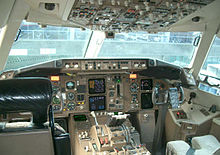A cockpit of the 767-300ER, which exhibits a hybrid adoption of a new-generation instrument panel and analog gauges and indicators.