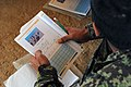 Afghan National Army recruit studies literacy course materials during Regional Basic Warrior Training at the Regional Military Training Center in Kandahar.jpg