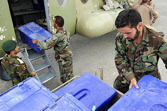 2009 Afghan presidential election - Soldiers of the Afghan National Army unloading election ballots at U.S. Forward Operating Base Orgun-E on August 16, 2009.