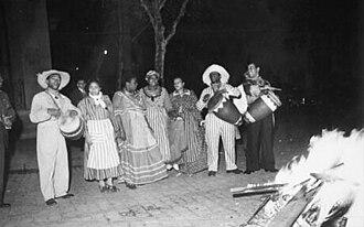 Candombe - Afro-Argentines playing Candombe Porteño near a bonfire in St. John's night (noche de San Juan), 1938.