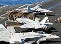 Aircraft move around the flight deck of USS Nimitz. (8227414744).jpg