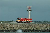 An Airservices Australia fire appliance travelling beside the runway at Sydney Airport on 5 January 2008.