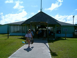 "Aitutaki Airport - Entrance to Aitutaki Airport. Note the sign ""Aitutaki International Airport"", although there are no international flights."