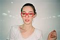 Aline de Bairros with red glasses.jpg