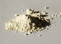 Photo of a sample of ammonium vanadate