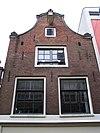 foto van Huis met gekuifde klokgevels