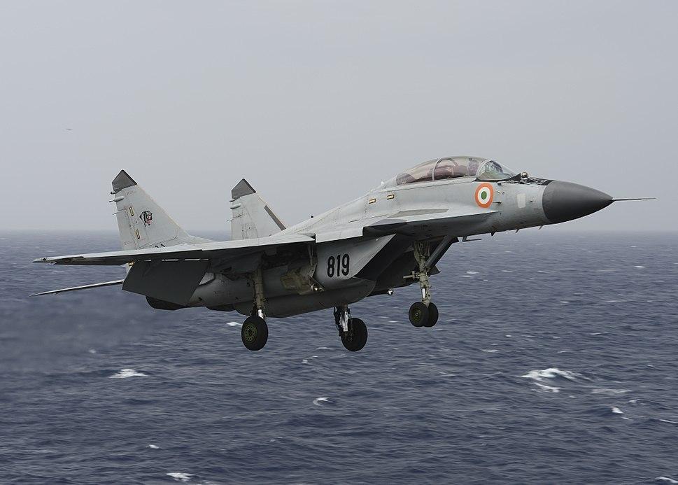 An Indian Navy MIG-29K Fulcrum flies over the aircraft carrier USS Nimitz (CVN 68) during Exercise Malabar 2017
