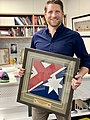Andrew Hastie MP with flag gifted to him by SASR operators January 2020 photo taken by D Birch.jpg