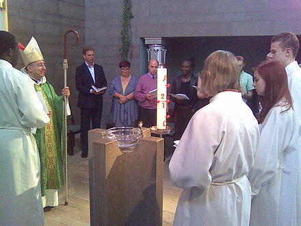 David Hamid, suffragan bishop in Europe, administering an Anglican Confirmation in Helsinki Anglican confirmation in Helsinki.jpg
