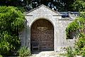Arched entrance to the Walled Garden summerhouse at Parham House, West Sussex, England.jpg
