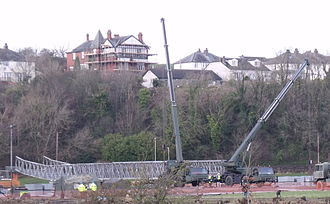 2009 Workington floods - Mill Field on 3 December 2009. Army engineers working 24-hour days to construct the footbridge