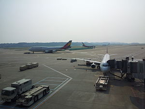 English: A trio of Asiana Airlines aircraft at...