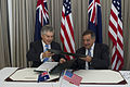 Australian Minister for Defence Stephen Smith, left, and Secretary of Defense Leon E. Panetta exchange folders as they sign a memorandum of understanding during the Australia-U 121114-D-BW835-947.jpg