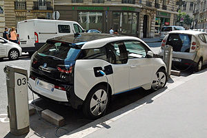 Autolib' - A privately owned BMW i3 charging at an Autolib' station in Paris.