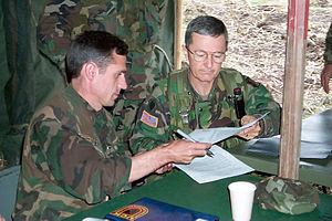 Bantz J. Craddock - Craddock speaking with a Kosovar soldier in June 1999.