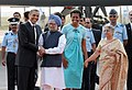 Barack Obama and the First Lady Mrs. Michelle Obama being received by the Prime Minister, Dr. Manmohan Singh and his wife Smt. Gursharan Kaur, on their arrival, at Palam Air Force Station, in New Delhi on November 07, 2010.jpg