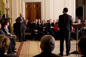President Barack Obama listens to Senator Edwa...