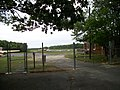 Bayport Aerodrome; Wind Sock behind Fence.JPG