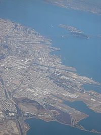 A bird's-eye view of the Bayview/Hunters Point neighborhood of San Francisco. Candlestick Park, a Football stadium, is in the foreground