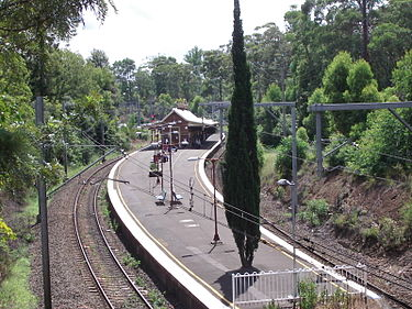 Beecroft railway station in Sydney, Australia, is an island-platform station in the middle of a reverse curve. This platform is accessed by an underpass. Beecroftstationsyd.jpg