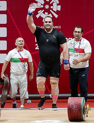 Behdad Salimi - Salimi with coaches at the 2018 Asian Games