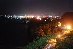 Skyline of Bislig City on night time showing the nearby Bislig Bay taken at the Ocean View Park in Barangay Comawas