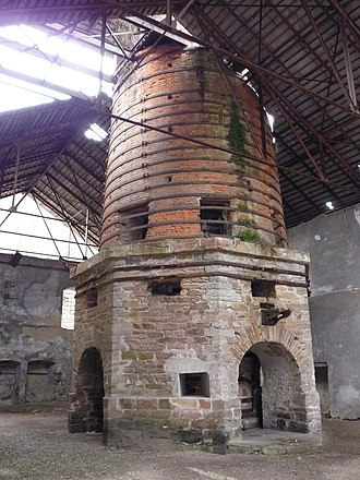 "Govăjdia Blast Furnace - Octagonal stone base, conical brick body wrapped in iron girdles, dotted with blast holes. Construction began in 1806, and although finished in 1810, production only began in April 1813, A tablet placed on the front of the furnace read: Augusto Imperante Francisco Extructum 1810 (""Built 1810 during the reign of the venerable Francis"")."