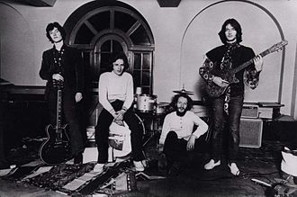 Eric Clapton - Blind Faith in 1969, with Clapton standing far right