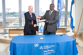 David M. Malone - David M. Malone, Rector (left) shaking hands with Ernest Aryeetey (right), Vice Chancellor, University of Ghana