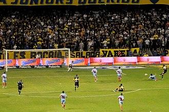 Juan Román Riquelme - Riquelme scoring in Boca's 4–0 victory against Arsenal de Sarandí on 12 April 2010.
