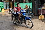 Boy riding a motorcycle in Laos.jpg