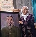 Bubush Osmonalieva with her father's picturesque portrait, in Kochkor. 07.8.2014.jpg