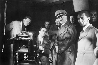 Nazism and cinema - Adolf Hitler, Joseph Goebbels, and others watch filming at Ufa, 1935.