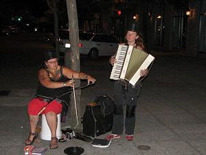 Gratuity - Buskers often punctuate their performances with requests for tips