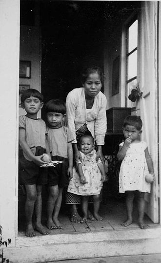 Nanny - A baboe and the children in her care in the Dutch East Indies (now Indonesia). 1934