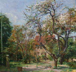 House in a garden with fruit trees in bloom