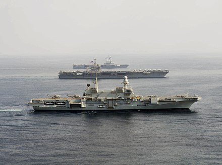 Cavour (foreground) operating with Harry S. Truman (middle) and Charles de Gaulle (background) in the Gulf of Oman, 2013