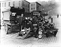Chief Inspector LJ Allen of the Weights and Measures Division with condemned weights and scales, Terrace St between 4th Ave and (LEE 28).jpeg
