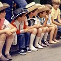 Children watching the Calgary Stampede Parade (28324773305).jpg