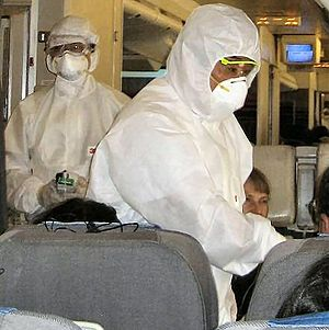 English: Chinese inspectors on an airplane, ch...